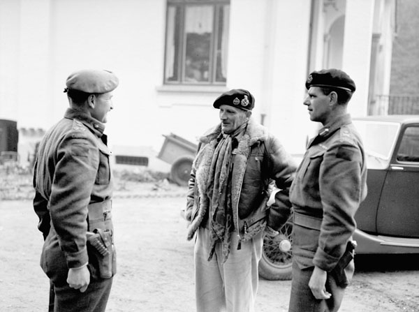 Field Marshal Sir Bernard Montgomery (centre), Commander-in-Chief of the 21st Army Group, talking with Brigadier J.C. Jefferson (left), Commander of the 10th Canadian Infantry Brigade, and Major-General Harry W. Foster, General Officer Commanding 4th Canadian Armoured Division, at 4th Canadian Armoured Division Headquarters, Eikelenberg, Belgium, 28 October 1944.