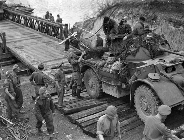 A General Motors Staghound T-17E1 armoured car of the 12th Manitoba Dragoons crossing a Bailey bridge, Elbeuf, France, 28 August 1944.