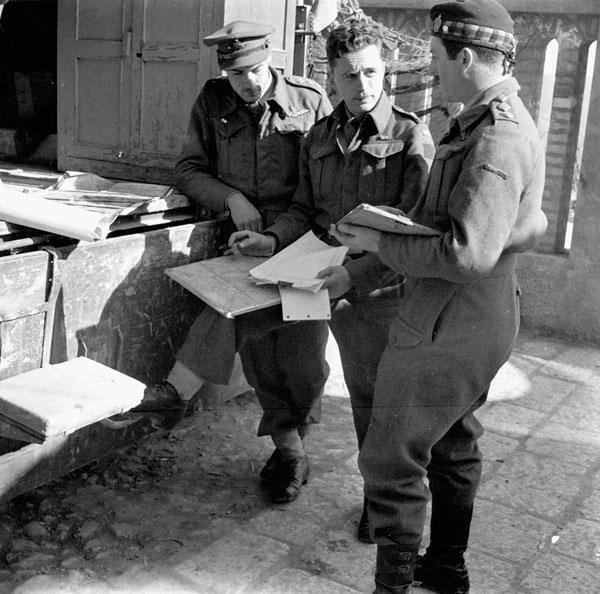 Briefing of pilots of No.654 Air Observation Post Squadron, Royal Air Force (R.A.F.), operating in support of regiments of the Royal  Canadian Artillery (R.C.A.), Castel Frentano, Italy, 10 February 1944.