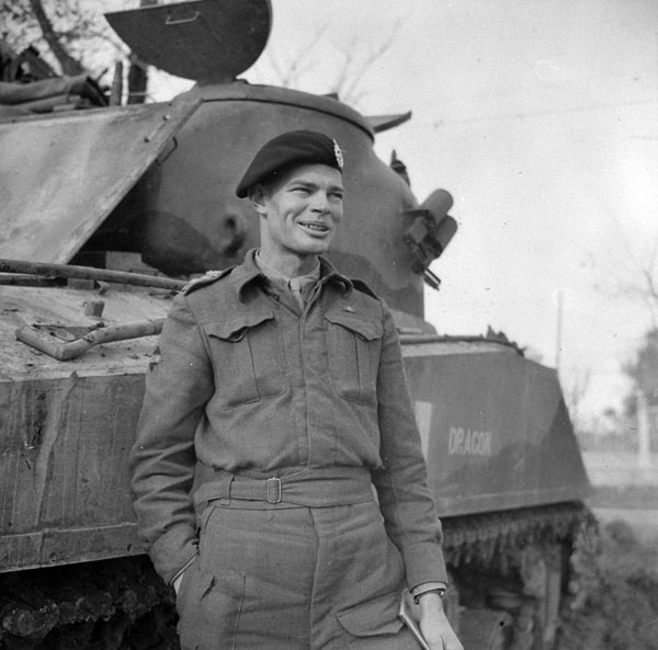 Captain W.H. Ellis of The Ontario Regiment hearing the news that he will attend staff college in Canada. Lanciano, Italy, 8 February 1944.