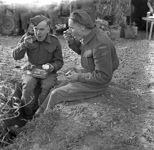 Sappers F.R. Fuller and Harry Rennie of the Royal Canadian Engineers (R.C.E.) eating dinner, Castel Frentano, Italy, 20 December 1943.