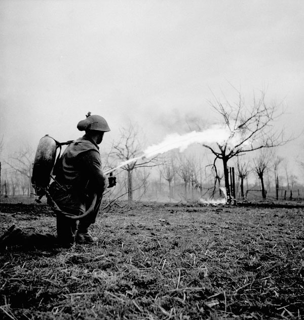 Lance-Corporal J.E. Cunningham of The Essex Scottish Regiment practices firing a Lifebuoy flamethrower near Xanten, Germany, 10 March 1945.