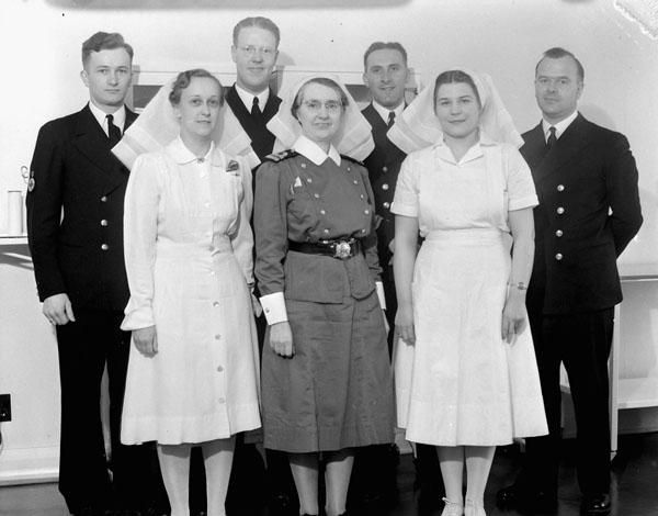 Operating Room staff, Royal Canadian Naval Hospital, St. John's, Newfoundland, 25 May 1942.