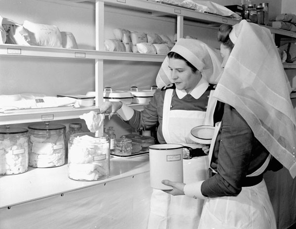 Nursing sisters dispensing medical supplies at the Royal Canadian Naval Hospital, St. John's, Newfoundland, ca. 1942.
