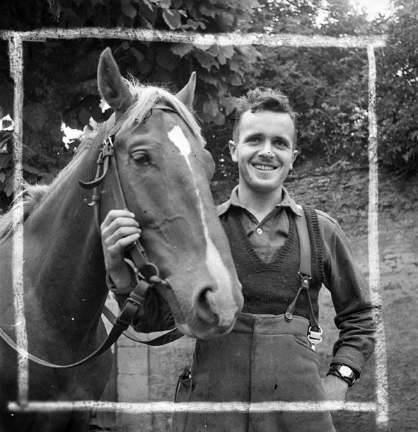 Sergeant T.F. McFeat with Bijoux, a captured horse taken on strength by a Field Ambulance unit of the Royal Canadian Army Medical Corps (R.C.A.M.C.) and the 9th Canadian Infantry Brigade, France, 6 July 1944.