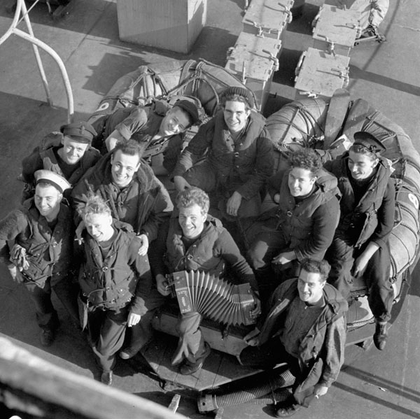 Off-duty personnel holding a singsong aboard the destroyer H.M.C.S. OTTAWA at sea, 22 November 1943.