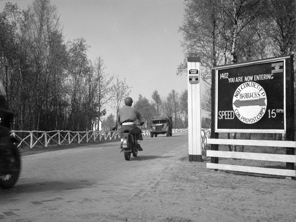 Entrance gate sign at No.1 Canadian Field Punishment Camp (Canadian Army Miscellaneous Units), Vught, Netherlands, ca. 21-23 April 1945.