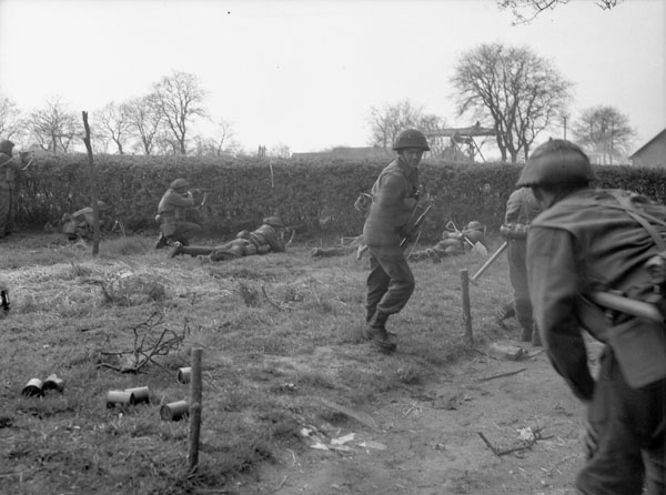 Infantrymen of The South Saskatchewan Regiment firing through a hedge during mopping-up operations along the Oranje Canal, Netherlands, 12 April 1945.