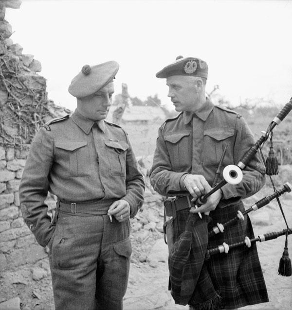Regimental Sergeant-Major L.D. Burnet and Pipe Major Samuel Cott, both of The Cameron Highlanders of Ottawa (M.G.), near Caen, France, 15 July 1944.