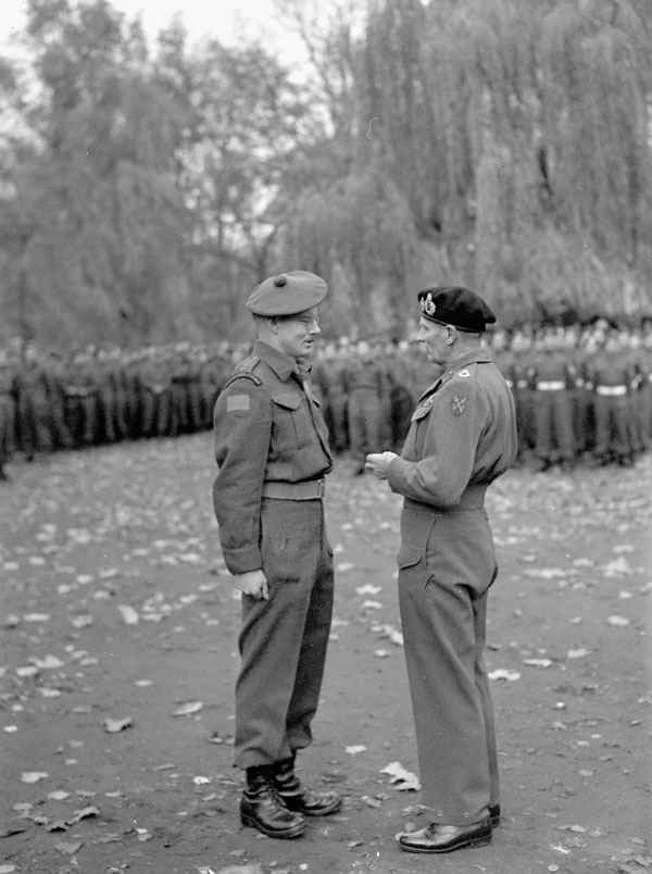 Field Marshal Sir Bernard Montgomery investing A/Captain J.C. Woodward of The Cameron Highlanders of Ottawa (M.G.) with the Military Cross, Ghent, Belgium, 5 November 1944.