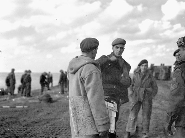Major R.A. Cottrill (right) of  The Queen's Own Rifles of Canada talking with Major J.L. Dampier,  General Staff Officer II (G.S.O. II ) of the 3rd Canadian Infantry Division, Terneuzen, Netherlands, 13 October 1944.