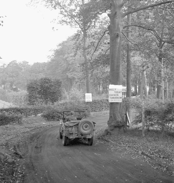 "Sign which reads ""Bully Today - Beef Tomorrow"" posted by the Canadian Provost Corps (C.P.C.) to boost sales of Victory Bonds during the Seventh Victory Loan campaign, Belgium, 11 October 1944."