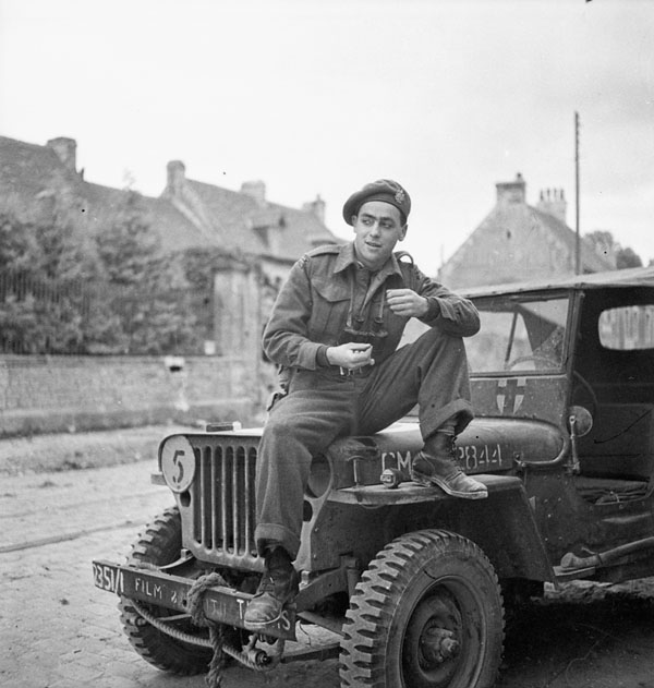 Private Charlie Ross, Canadian Army Film and Photo Unit, 11 July 1944.
