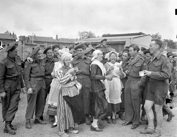 Dutch women having tea with personnel of the 3rd Canadian Infantry Division during the Division's Sports Day, Hilversum, Netherlands, 14 June 1945.