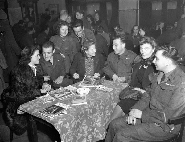 Personnel of the 4th Canadian Armoured Division and their Dutch fiancées, Amersfoort, Netherlands, 16 November 1945.