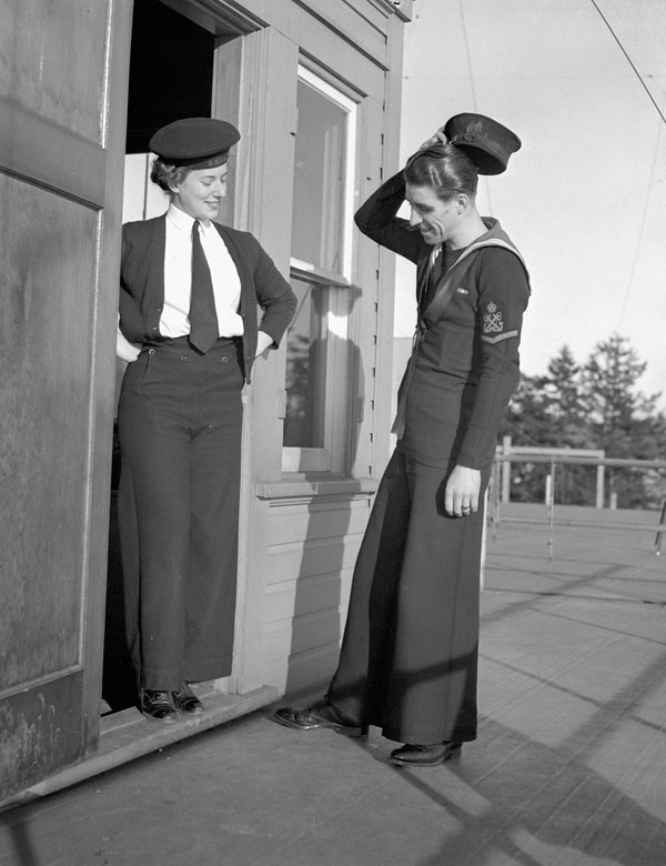Unidentified signallers of the Women's Royal Canadian Naval Service (W.R.C.N.S.) and Royal Canadian Navy (R.C.N.) comparing bellbottom trousers, Vancouver, British Columbia, Canada, 22 February 1944.