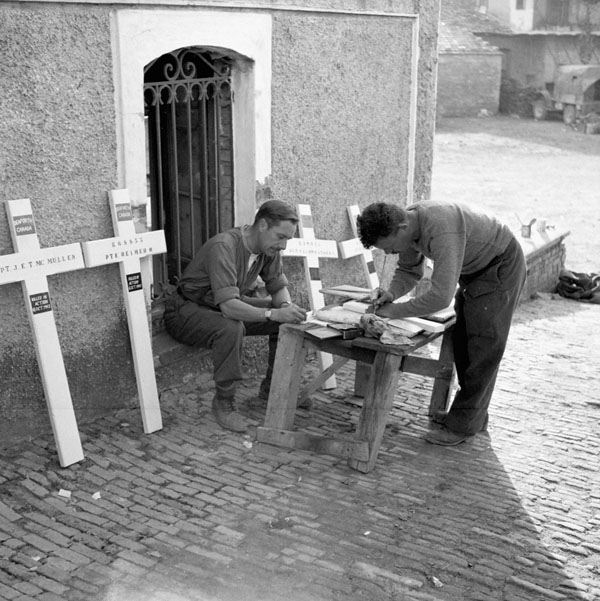 Corporal W.F. Blackwood and Private R.J. Barnes, both of the Pioneer Platoon, The Seaforth Highlanders of Canada, preparing  grave crosses for casualties, Baranello, Italy, 19 October 1943.