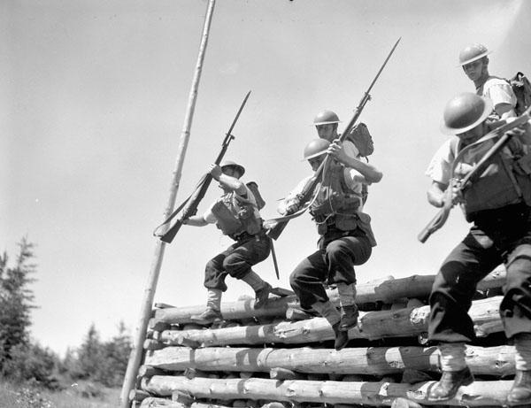 Assault course, Gunnery School, H.M.C.S. CORNWALLIS, Deep Brook, Nova Scotia, Canada, 21 July 1944.