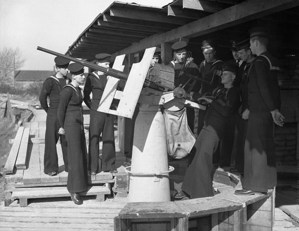 Defensively Armed Merchant Sips (D.E.M.S.) personnel learning to fire an Oerlikon 20mm anti-aircraft gun,  Esquimalt, British Columbia, Canada, 15 March 1944.