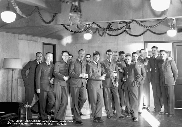A group of officers in the Officer's Mess on Christmas Day, Royal Canadian Air Force Station Coal Harbour, British Columbia, Canada, 25 December 1941.