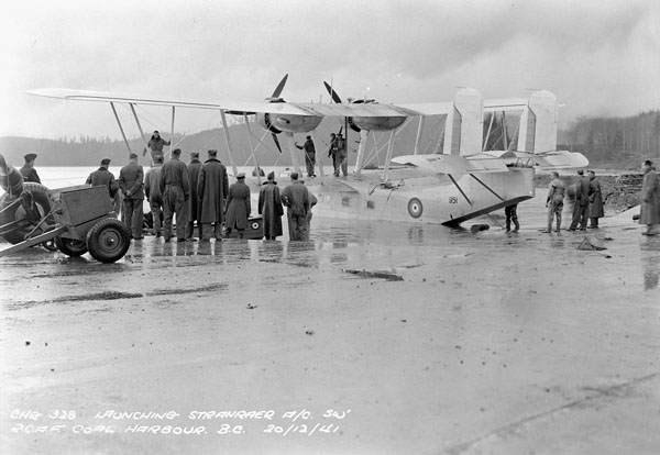 Groundcrew launching Supermarine Stranraer flying boat 951 of No.120(BR) Squadron, R.C.A.F., at Royal Canadian Air Force Station Coal Harbour, British Columbia, Canada, 20 December 1941.
