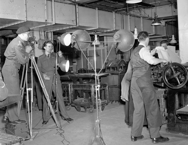 The Canadian Army Film and Photo Unit shooting a film  about the production of the United Kingdom edition of the Maple Leaf newspaper, London, England, 7 June 1945.