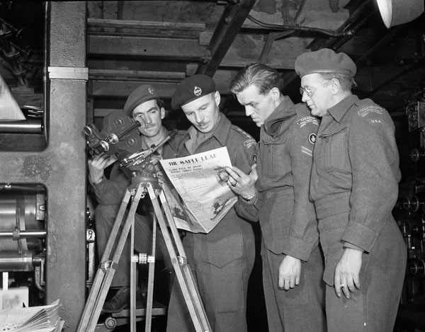 Personnel of the Canadian Army Film and Photo Unit who shot the film about the production of the  United Kingdom edition of the Maple Leaf newspaper, London, England, 7 June 1945.