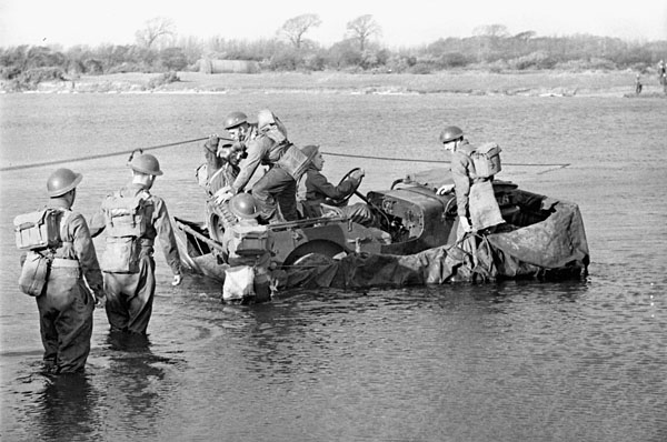 Gunners of the 2nd Anti-Tank Regiment, Royal Canadian Artillery (R.C.A.), practicing river crossing during a training exercise, Bognor Regis, England, 14 December 1942.