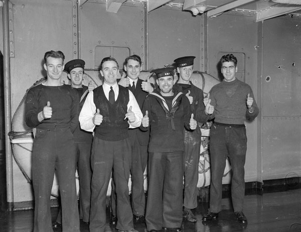 Seven unidentified Canadian sailors who survived the sinking of the armed merchant cruiser H.M.S. JERVIS BAY by the German battleship ADMIRAL SCHEER  while escorting Convoy HX-84 on 5 November 1940.
