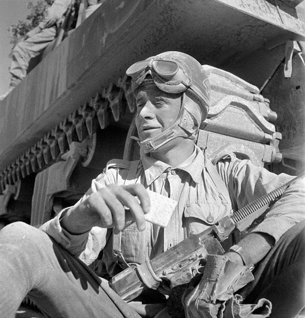 Trooper T.H. Baker, a despatch rider of The Calgary Regiment, near Villapiana, Italy, 18 September 1943.