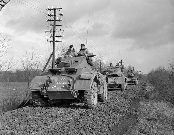 "General Motors T17E1 Staghound armoured cars of ""A"" Squadron, 12th Manitoba Dragoons, in the Hochwald, Germany, 2 March 1945."