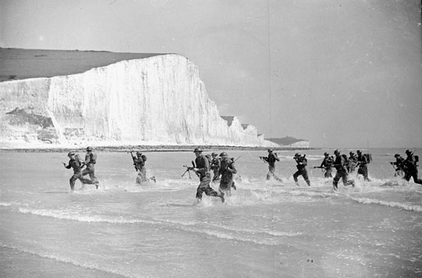 Canadian infantrymen taking part in an assault landing training exercise, Seaford, England, 8 May 1942.