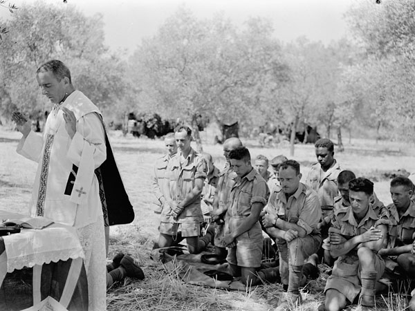 H/Captain J.S. Mullaney conducting  a mass for troopers of the First Canadian Army Tank Brigade in Sicily, Italy, 8 August 1943.