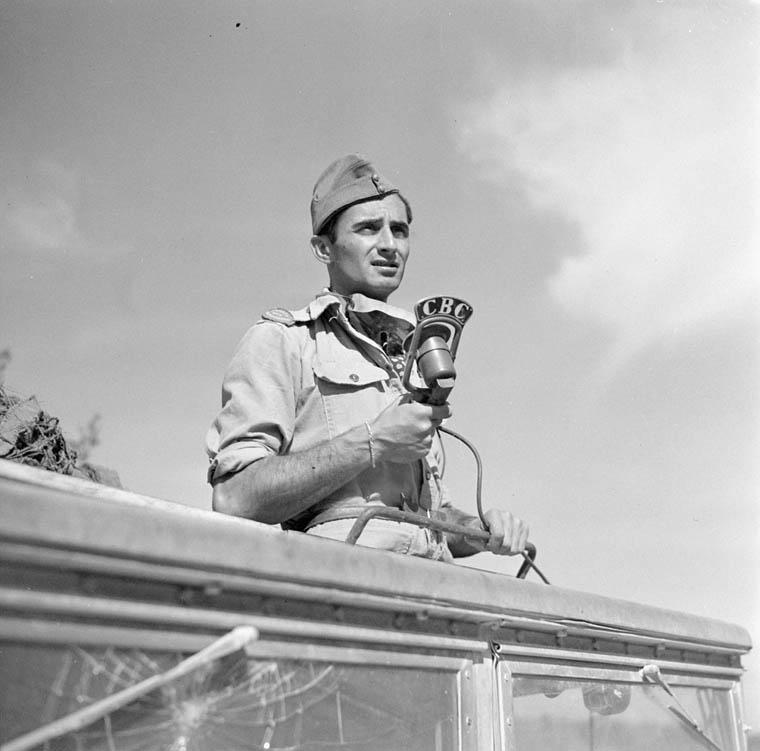 War correspondent Peter Stursberg of the Canadian Broadcasting Corporation recording a radio broadcast, Potenza, Italy, 22 September 1943.