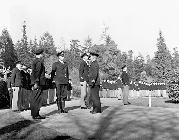 Captain J.W. Grant inspecting personnel during Divisions, H.M.C.S. ROYAL ROADS, Victoria, British Columbia, Canada, March 1941.