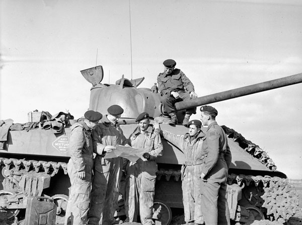 Personnel of the Governor General's Foot Guards with a Sherman tank, Bergen op Zoom, Netherlands, 6 November 1944.