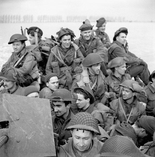 Infantrymen of the Stormont, Dundas and Glengarry Highlanders aboard a Buffalo amphibious vehicle near Mehr, Germany, 11 February 1945.