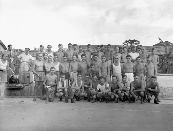 Canadian and British prisoners-of-war who were liberated by a boarding party landed from H.M.C.S. PRINCE ROBERT, Kowloon, Hong Kong, August 1945.