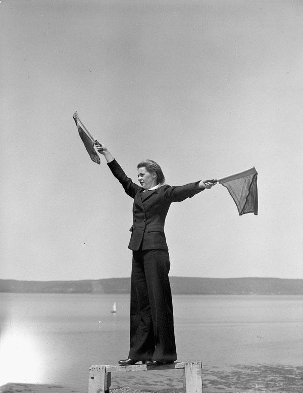 Signaller Irene Cheshire of the Women's Royal Canadian Naval Service (W.R.C.N.S.), H.M.C.S. CORNWALLIS, Deep Brook, Nova Scotia, Canada, August 1945.