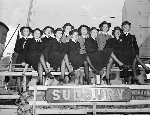 Members of the Women's Royal Canadian Naval Service (W.R.C.N.S.) aboard H.M.C.S. SUDBURY celebrating the first anniversary of the formation of the W.R.C.N.S.. Halifax, Nova Scotia, Canada, 19 August 1943.