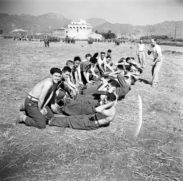 Patients performing back exercises, No.1 Convalescent Depot, Royal Canadian Army Medical Corps (R.C.A.M.C.), Salerno, Italy, ca.1-2 May 1944.