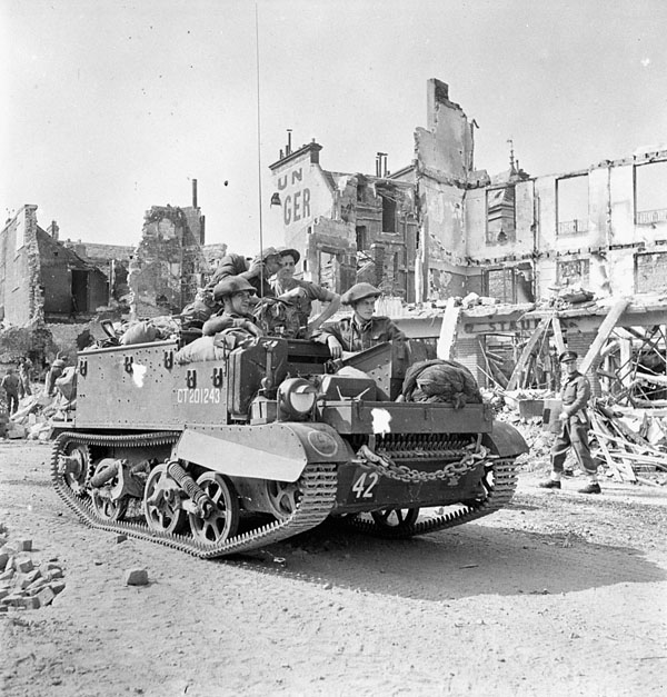 A Universal Carrier of the 4th Field Regiment, Royal Canadian Artillery (R.C.A.), Vaucelles, France, 18 or 20 July 1944.