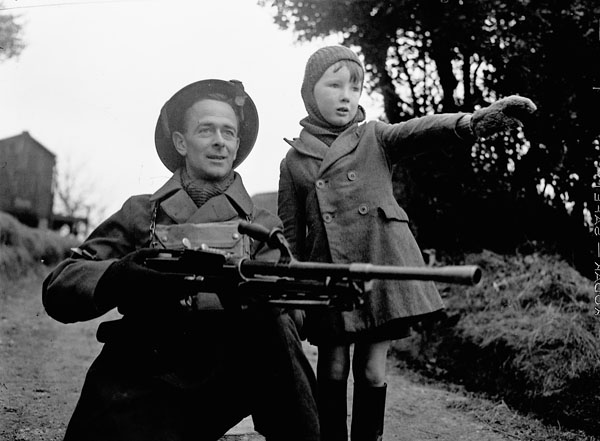 An unidentified infantryman of The Essex Scottish Regiment storming a village during a training exercise,  St. Leonards, England, 24 February 1942.