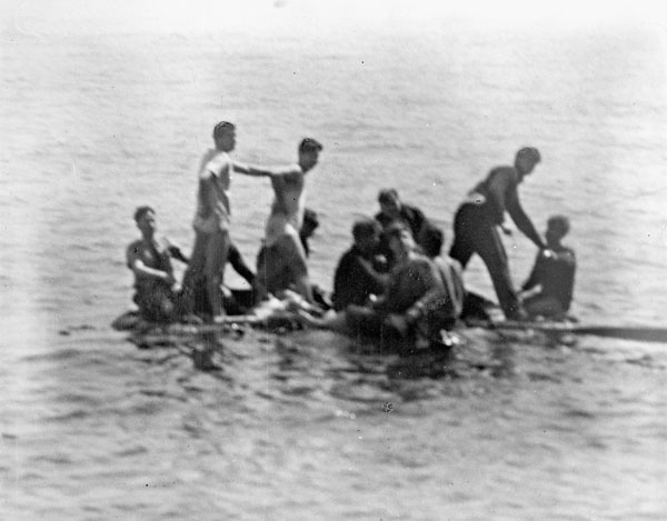 Survivors of the minesweeper H.M.C.S. ESQUIMALT, which was torpedoed by the German submarine U-190, awaiting rescue at sea off Halifax, Nova Scotia, Canada, 16 April 1945.