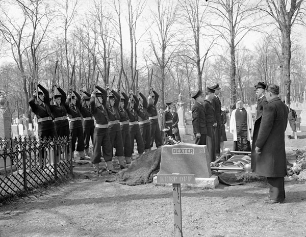 Funeral of a victim of the sinking of the minesweeper H.M.C.S. ESQUIMALT, which was torpedoed by the German submarine U-190 on 16 April 1945, Halifax, Nova Scotia, Canada, April 1945.