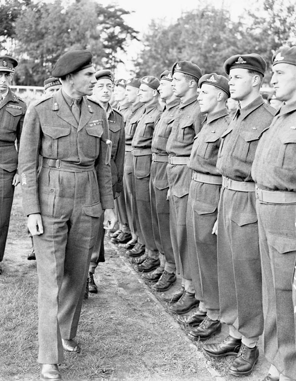 Lieutenant-General G.G. Simonds, General Officer Commanding 2nd Canadian Corps, inspecting personnel of the Royal Canadian Artillery (R.C.A.), Meppen, Germany, 31 May 1945.
