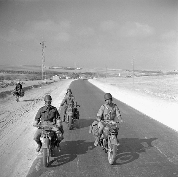 Canadian despatch riders near Tunis, Tunisia, July 1943.
