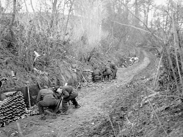 Infantrymen of the 1st  Battalion, The Canadian Scottish Regiment, firing three-inch mortars at German positions on islands in the flooded Rhine River, Niel, Germany, 8 February 1945.