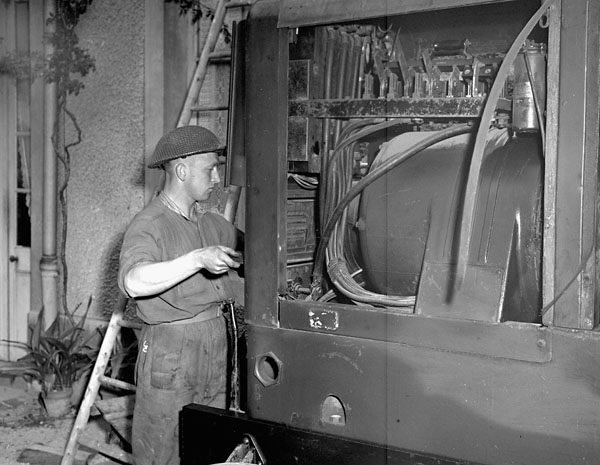 Generator providing electricity for the press printing the first issue of the Maple Leaf newspaper, Caen, France, 28 July 1944.
