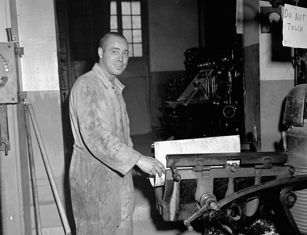 Lance-Corporal Frank Dubois casting a plate during the printing of the first issue of the Maple Leaf newspaper, Caen, France, 28 July 1944.